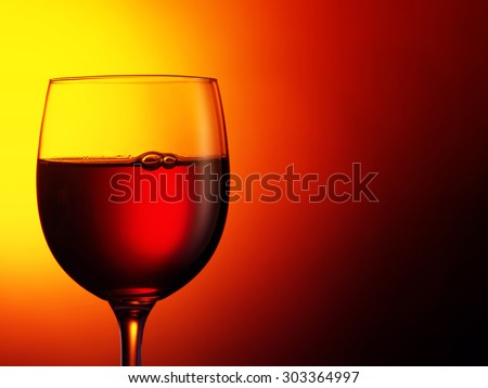 glass of red wine on dark red background. Filtered image: warm cross processed vintage effect. - stock photo