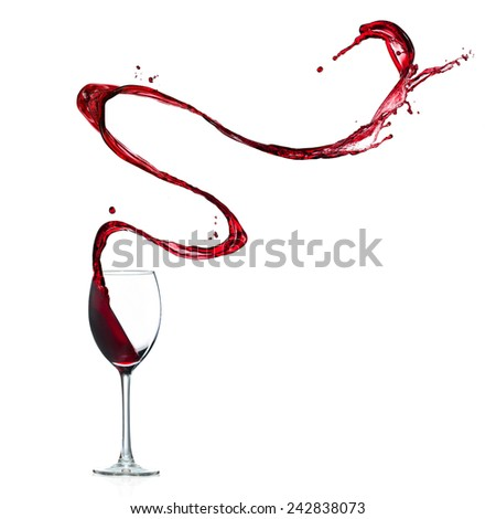 Glass of red wine splashing out, isolated on white background - stock photo