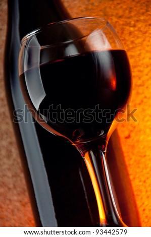 Glass of red wine, studio shot, close-up - stock photo