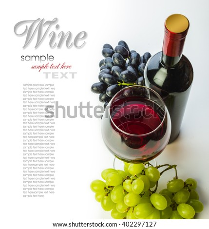 glass of red wine with bottle and grapes on a white background - stock photo