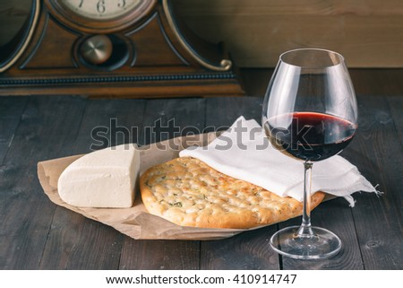 Glass of red wine with clock background - stock photo