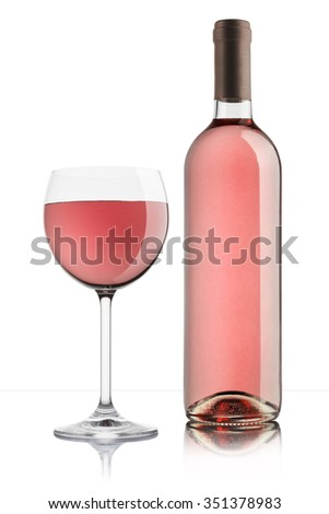 glass of rose wine with full bottle on white background - stock photo