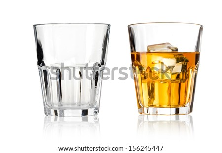 Glass of scotch whiskey and empty glass on a white background - stock photo