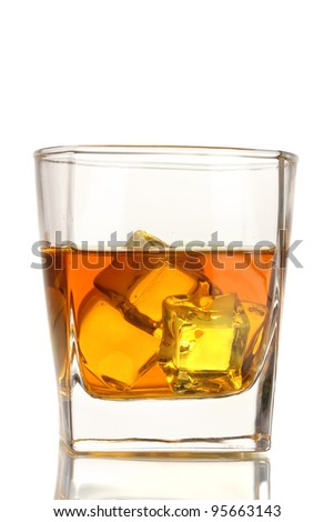 Glass of scotch whiskey and ice isolated on white - stock photo