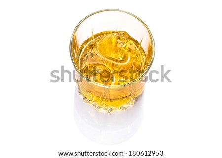 Glass of scotch whiskey on ice over white background - stock photo