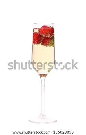 Glass of sparkling wine and strawberry. Isolated on white background. - stock photo