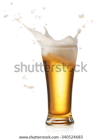 glass of splashing beer isolated on white - stock photo