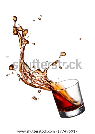 glass of splashing whisky isolated on white - stock photo
