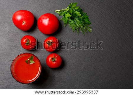 Glass of tasty tomato juice and fresh tomatoes - stock photo