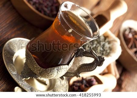 Glass of tea and tea leaves - stock photo