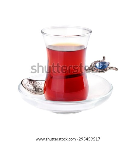 Glass of Turkish tea with spoon isolated on white background - stock photo