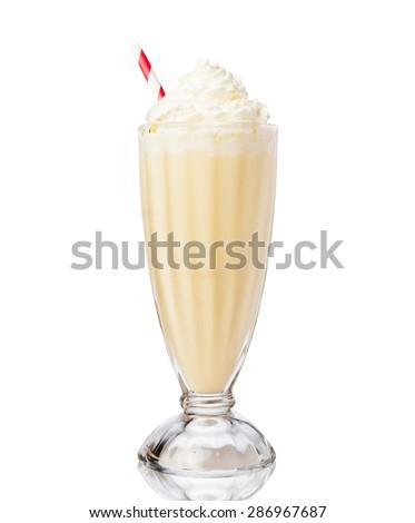Glass of vanilla milkshake with whipped cream isolated on white background - stock photo