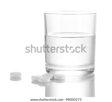 Glass of water and pills isolated on white - stock photo