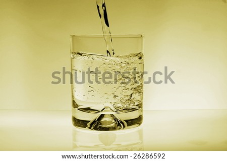 glass of water for refreshment in summer or at a party - stock photo