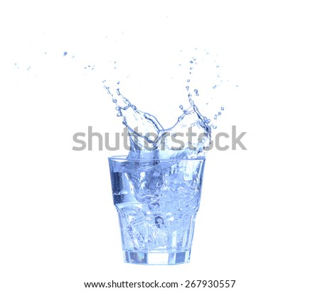 Glass of water, ice and slice of fresh lemon on a white background - stock photo