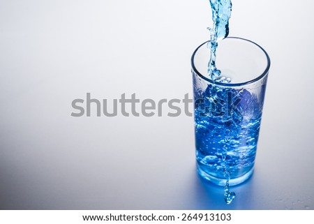 Glass of water on background - stock photo