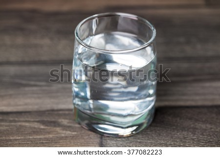 glass of water on wood background  - stock photo