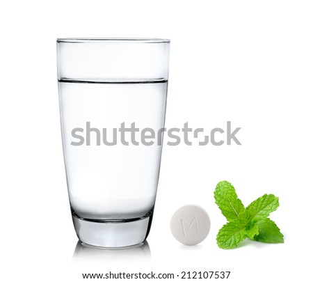 Glass of water pills and mint isolated on white background - stock photo