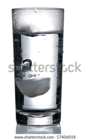 glass of water with ice cube isolated on white - stock photo