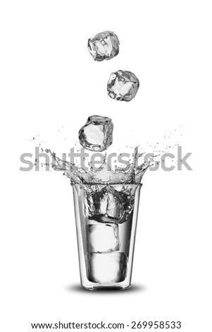 Glass of Water With Ice Cubes Falling - stock photo