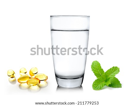 Glass of water with mint and fish oil isolated on white background - stock photo