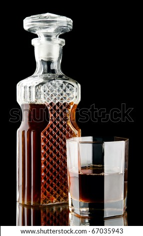 glass of whiskey and bottle - stock photo