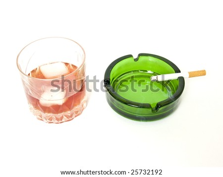 glass of whiskey, cigarettes and ashtray - stock photo