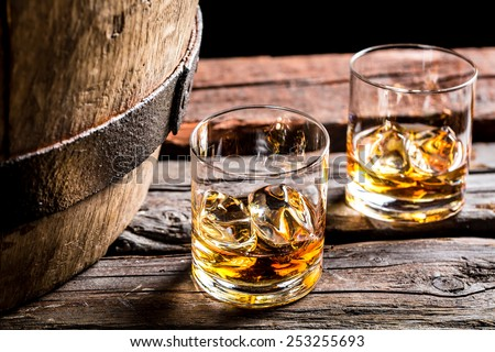 Glass of whiskey in the old cellar - stock photo