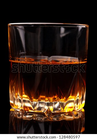 glass of whiskey on black background - stock photo