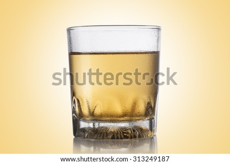 Glass of whiskey on color background. - stock photo