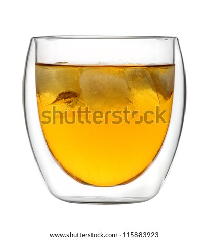 Glass of Whiskey on the rocks - with ice cubes against white background - stock photo