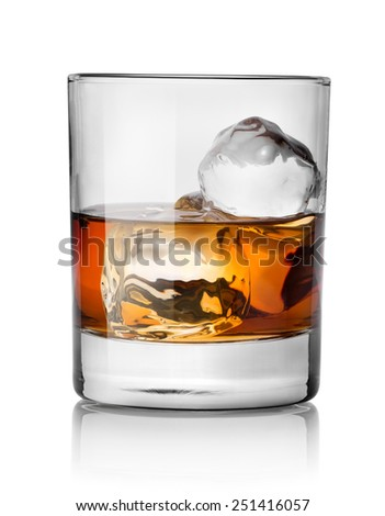 Glass of whiskey with ice isolated on white - stock photo