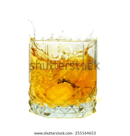 glass of whiskey with ice isolated on white background - stock photo