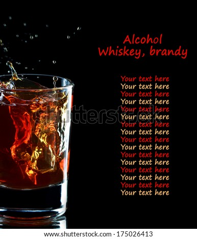 Glass of whiskey with splash on dark background, selective focus on the glass, place for text - stock photo