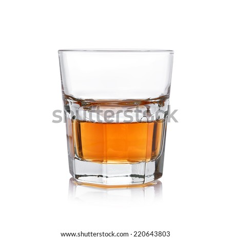 Glass of whisky on a white background. - stock photo