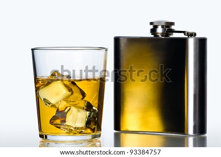 glass of whisky on the rocks  and stainless flask on white background - stock photo