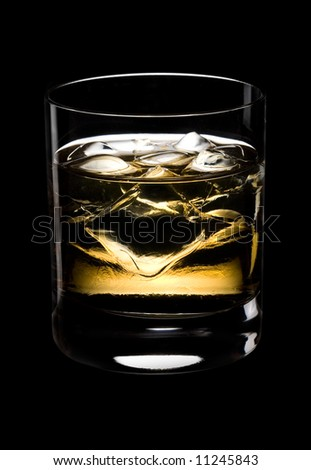 Glass of whisky with ice on a black background - stock photo