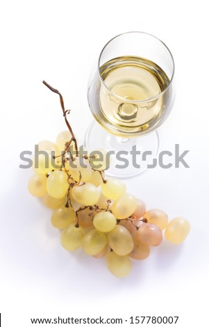 Glass of white wine and grapes from the top - stock photo