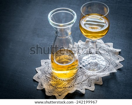 Glass of white wine in vintage decor - stock photo