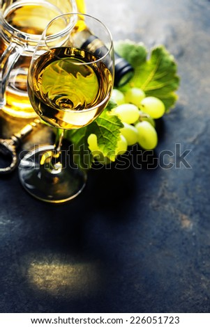Glass of white wine on dark background - stock photo
