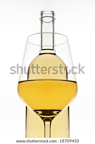 Glass of wine and bottle - stock photo