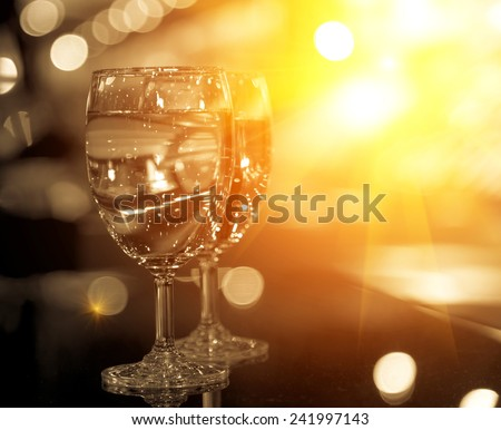 glass of wine on black background - stock photo