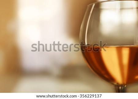 Glass of wine on blurred background - stock photo