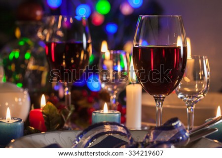 Glass of wine on the christmas table. Shallow depth of field - stock photo