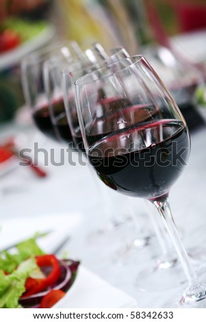 glass of wine on the white table - stock photo