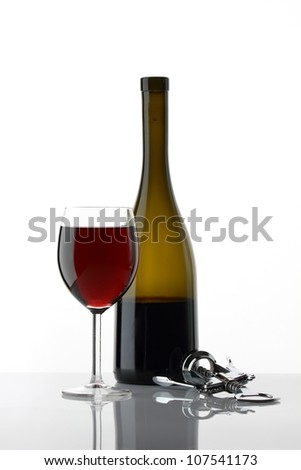 Glass of wine on white with reflection - stock photo
