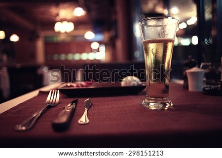 glass of wine restaurant interior serving dinner - stock photo