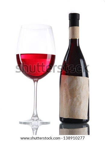 Glass of wine with bottle isolated on white - stock photo