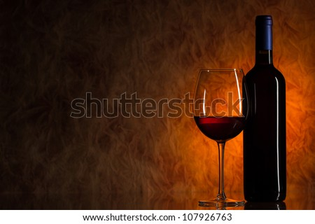 Glass of wine with bottle of wine - stock photo