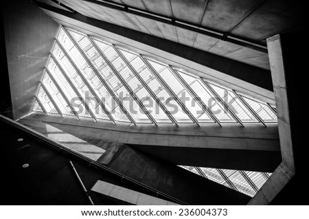 glass office buildings in wide angle view.Modern conceptual high tech building with abstract roof and stairs - stock photo